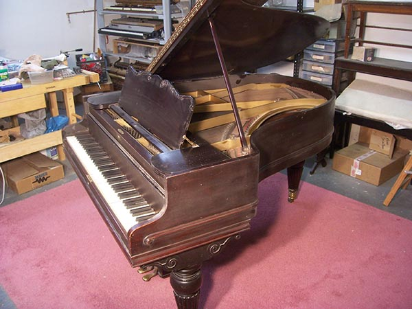 and this beautiful example of a turn-of-the-century art case piano ...
